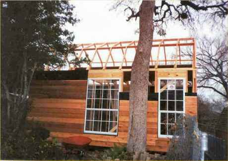 Windows installed before siding. Side view of roof trusses.
