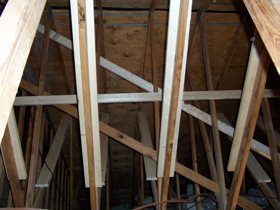 Superior In All Of These Photos, Dark Wood Is Original, White Wood Is New Work.  T Bracing Is The 2x6 Shown On Only One Truss. Cross Bracing Is The Level,  ...